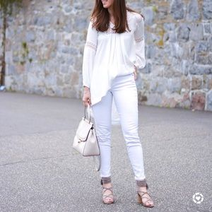 White tunic with crochet detail.